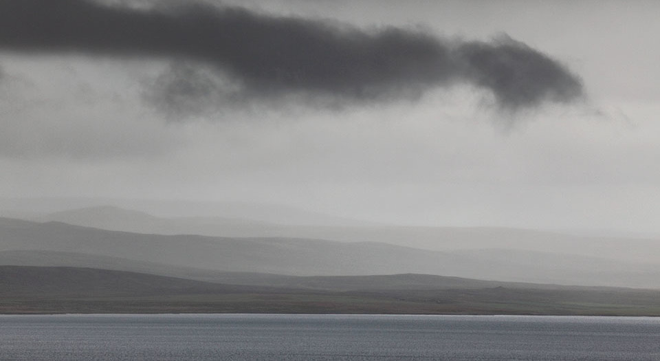 Tail Cloud over Icelandic Fjord